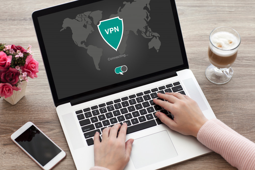 woman holding notebook with app vpn