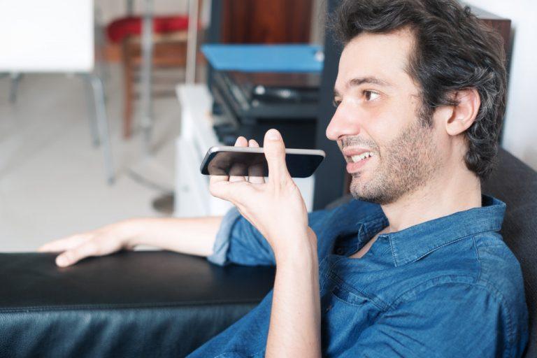 man speaking to his phone